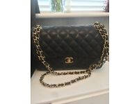 Chanel Authentic used Black Jumbo Quilted Lambskin Leather Flap Bag