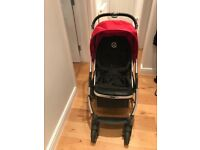 Oyster pushchair and carrycot includes red colour pack, sun umbrella, and rain covers
