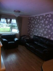 THREE SEATER SOFA AND ARMCHAIR FROM ROOMES OF UPMINSTER