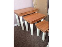 Oak furniture land bookcase, coffee table and nest of 3 tables
