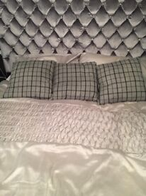 Three grey and black check felt cushions