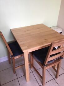 Table and 2 chairs and 2 stools
