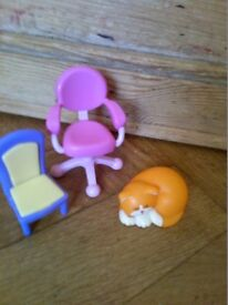 Three pieces of plastic dolls house furniture/accessories,two chairs and sleeping cat