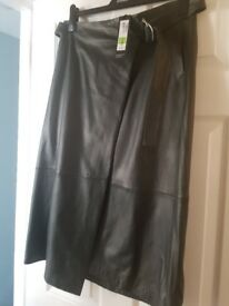 Grey leather skirt size 12 £30 .