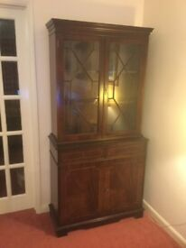 Cabinet/bookcase looking for a new home. Attractive pattern on cupboard doors and top glass doors.