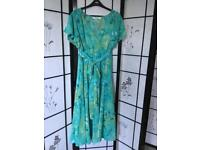 Plus size 22 sheer polyester dress. (Needs a petticoat!) in summer greens with shirred waist.