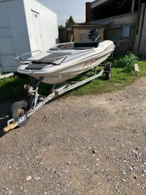 Speed boat with 90hp Mercury engine and trailer