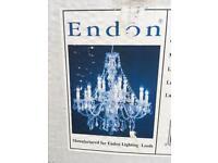 2x large acrylic chandeliers