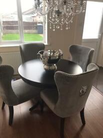 Black round table for sale *not the chairs*