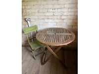 Wooden garden table and chair.