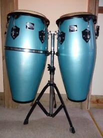 Pair of blue Sheila+Player Toca congas with stand, 11 inch and 10 inch heads. Pre-owned with cases