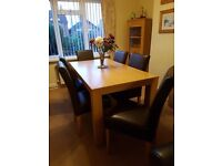 Dining room table and 6 leather chairs