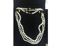 Fresh Water pearl necklace.Purchased in Brazil.18 Karat gold star clasps set with diamonds.