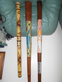 THREE DIDGERIDOOS IN EXELLENT CONDITION,ALL HAND MADE AND HAND PAINTED,ALL PLAYERS................