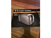 Brand new and boxed Silver Russell Hobbs 2 slice wide slot toaster