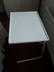 Mini-Table, folds flat for storage, legs push under chair or bed, adjustable height & table angle.