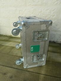 Large Aluminium Storage Case on Casters used as Coffee Table