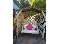 "Garden Swing Arbour for sale. H7ft W6ft 2"" D4ft. Cushions included. Buyer to dismantle and collect."