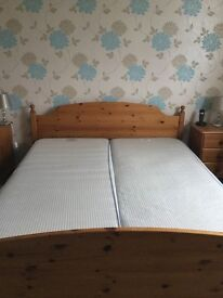 King size pine bed frame with mattress .