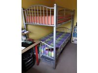 Bunk Beds: sturdy metal frame with mattresses