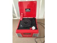 Record player in a red box for adults or children there is a few scratches on the top of the lead