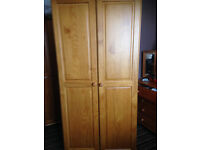 For sale a solid pine wardrobe, £55