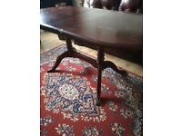 Wooden dining table with beautiful legs detail