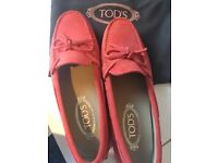 A new nice women pair of tods size 4/38