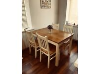 Extending cream and wood kitchen table with chairs
