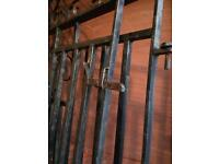 Wrought iron gates and wall toppers