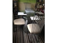 Dining table with 4 chairs. Selling as buying a new one . In used condition so selling cheap