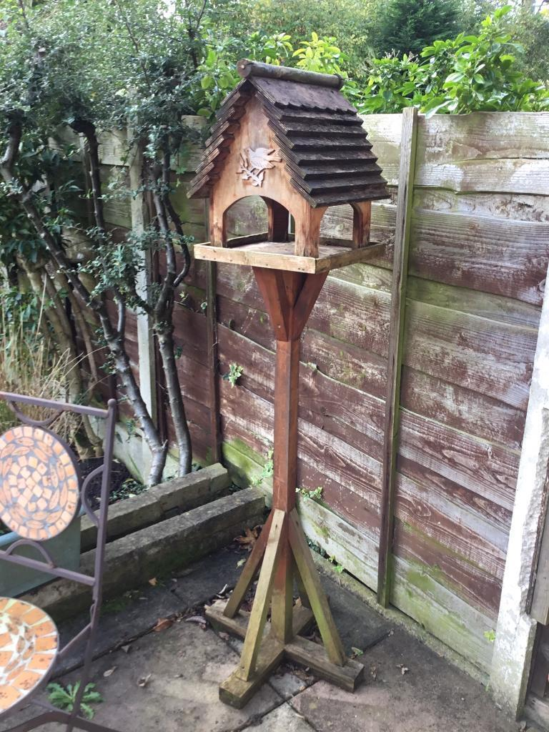 Free standing wooden bird table