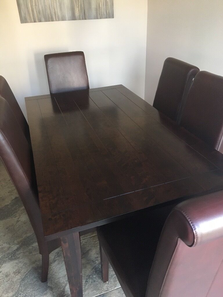 Next Dark Wood Dining Table and 6 Faux Leather Dining Chairsin Motherwell, North LanarkshireGumtree - Next Dark Wood Dining Table with panel inlays. 90cm width x 160 length. Next Dark Faux Leather Roll Back Dining Chairs with back seam detail. There are a few scratches to the table and legs of the chairs, but it has been well looked after. It comes...