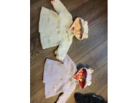 Bundle of baby girl clothes and blankets