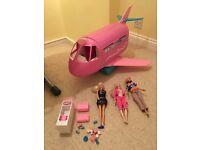 Barbie plane plus three dolls