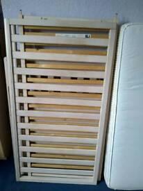 White drop side cot