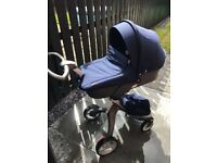 Stokke Full travel System with isofix, car seat, cosy toes, changing & shopping bag & rain covers