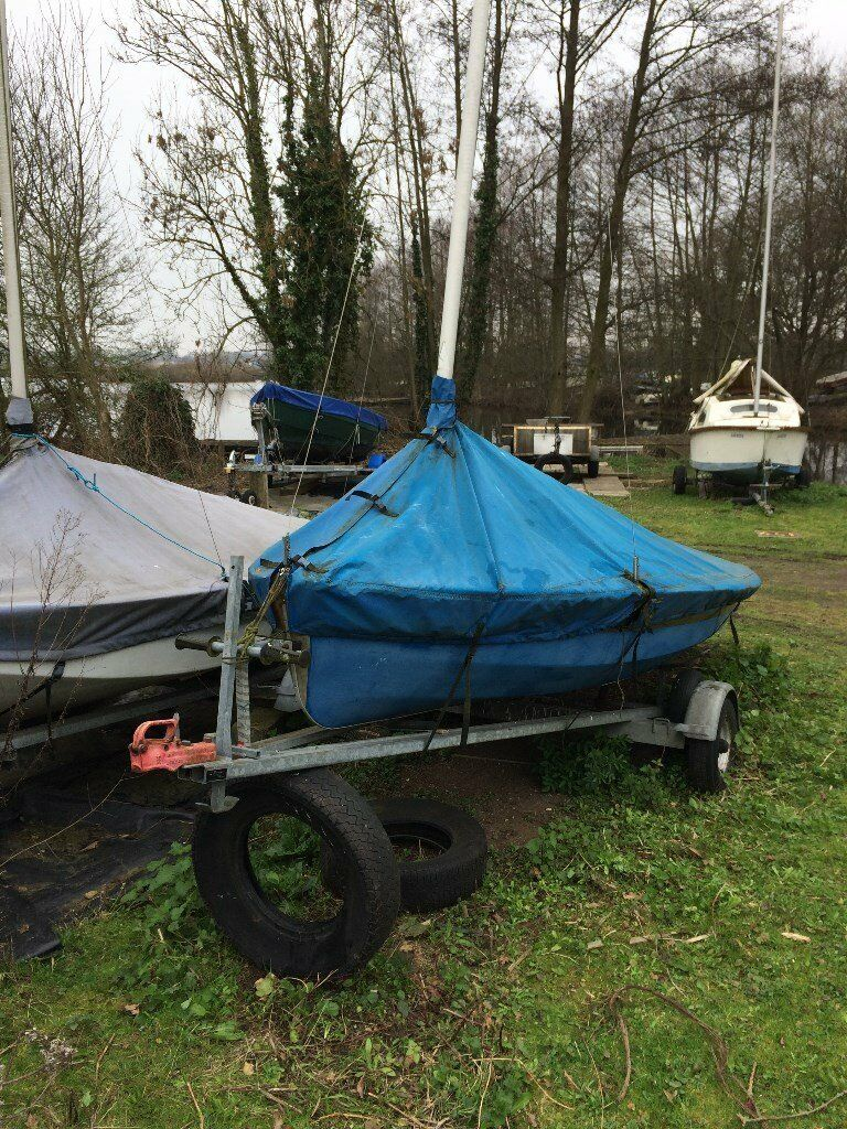 Solo Sailing Dinghy. Wood Hull, deck needs repair. Includes Combination Trailer / Launching Trolley