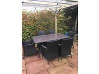 Garden table with 6 wicker chairs and cushions
