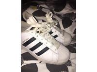 White and Black Adidas superstars