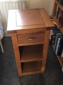 Solid oak telephone table. Excellent condition. Selling due to house move and lack of space.