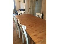 Near new condition extendable wooden table and 6 chairs