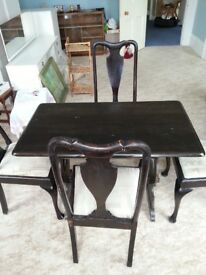 Dark stained and varnished table and chairs