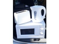 WHITE MICROWAVE. NEW TOASTER & KETTLE.