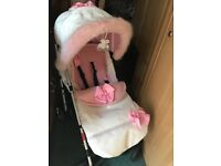 Pushchair pink and white diamonds and fur trim.