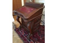 Antique 'rentier' desk in wood and leather with drawers to side, and lid top