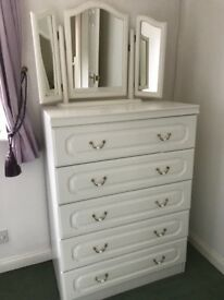 White large chest of drawers with triple mirror.