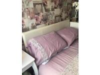 Cream leather bed