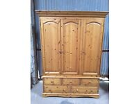 Triple wardrobe and chest of drawers.