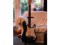 Stagg electric guitar with amp, stand and carrying case